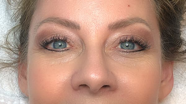 A image of woman's eyes after permanent eyebrows