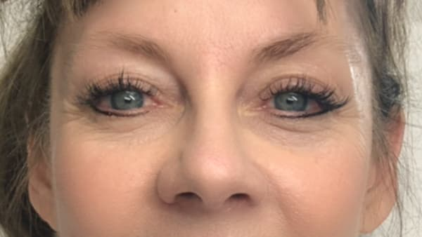 A image of woman's eyes before permanent eyebrows