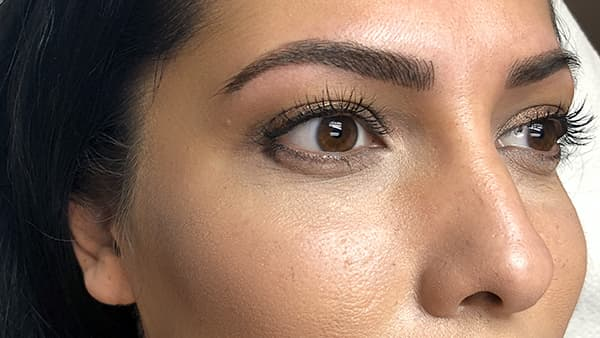 Image of a lady's eyes after permanent eyebrows