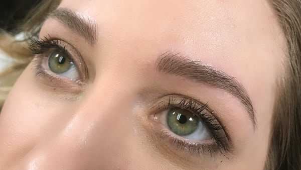 Eyes of a beautiful girl after applying eyeliner and permanent eyebrows