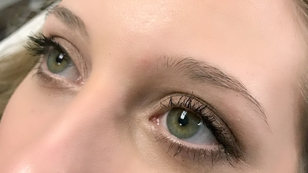 Eyes of a beautiful girl without applying eyeliner and permanent eyebrows