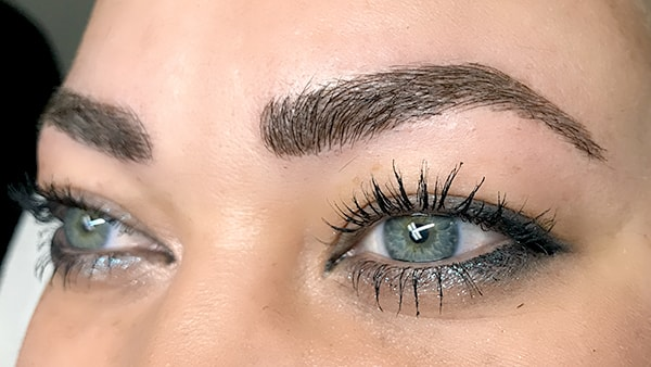 Image of eyes after using eyeliner and permanent eyebrows