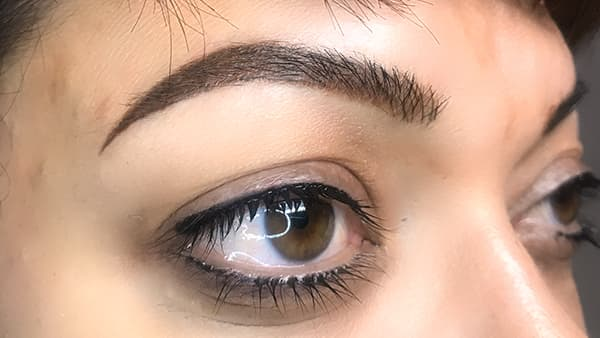 Sample image of eyes after applying eyeliner and permanent eyebrows