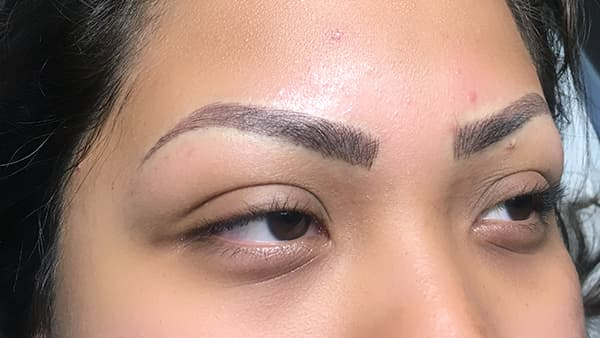 Image of girl's eyes after permanent eyebrows