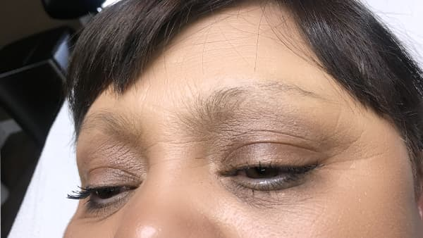 Image of eyes before permanent eyebrows