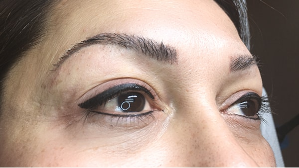 Image of eyes of a lady after eyeliner